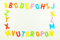 Alphabet magnets forming frame on whiteboard of colorful a Stock Photos
