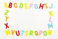 Alphabet magnets forming frame on whiteboard of colorful a Stock Photo