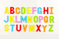 Alphabet magnets on whiteboard Royalty Free Stock Photo
