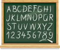 Alphabet and numbers on a blackboard