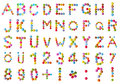 Alphabet and numbers in chocolate candy set of upper case letters of the formed from colourful or smarties isolated on a white Stock Images