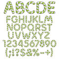Alphabet, numbers and signs from mint sweets. Royalty Free Stock Photo