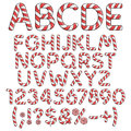 Alphabet, numbers and signs from red candies. Royalty Free Stock Photo