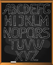 Alphabet sketchy on blackboard background. Royalty Free Stock Photo