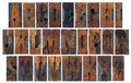 Alphabet vintage letterpress wood type blocks french clarendon font popular western movies memorabilia collage isolated letters Royalty Free Stock Photos
