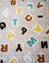 Alphabets on a Fabric Carpet Surface