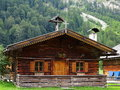 Traditional cottage in alpine landscape Royalty Free Stock Photo