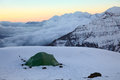 Alpine camping in high snow-covered mountains Royalty Free Stock Photo