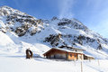 Alpine chalet house and mountain panorama with snow in winter in Stubai Alps Royalty Free Stock Photo