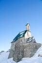 Alpine chapel against a deep blue sky ii eighteen hundred era at feet Stock Photo