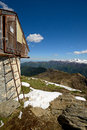 Alpine hut with view emergency wooden and old weather shelter in majestic high mountain scenery in spring season location gran Royalty Free Stock Photography
