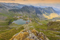 Alpine lake and curved road in mountains,Transfagarasan,Fagaras mountains,Carpathians,Romania Royalty Free Stock Photo