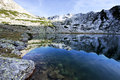 Alpine lake reflection - Retezat Mountains Stock Photography