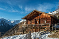 Alpine lodge in austria the mountains of matrei osttirol a beautiful winter s day with snow sunshine and a blue sky Royalty Free Stock Image