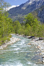 Alpine mountain river in Swiss Alps green valley Royalty Free Stock Photo