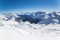 Alpine panorama showing snow covered mountains clear blue sky Stock Photos