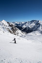 Alpine panorama showing snow covered mountains clear blue sky skiers preparing route Royalty Free Stock Images