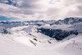Alpine panorama showing snow covered mountains cloudy dramatic sky Stock Photography