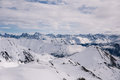 Alpine panorama showing snow covered mountains cloudy dramatic sky Stock Photos