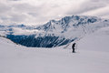Alpine panorama showing snow covered mountains cloudy sky skier preparing skiing Royalty Free Stock Photos