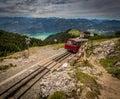 Alpine rack railway track to Schafberg, where steam train takes tourists on a mountain peak in the Austrian Alps near Salzburg Royalty Free Stock Photo