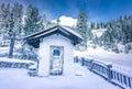 Alpine rustic chapel in winter decor Royalty Free Stock Photo