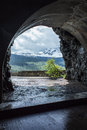 Alpine scenery framed by a tunnel is opening on going to the sun road in montana s glacier national park Royalty Free Stock Images
