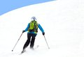 Alpine ski female skier turning in deep powder with mountains valley s Royalty Free Stock Image