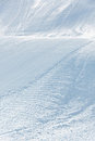 Alpine ski piste with ski and snowboard tracks Stock Photography