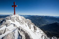 Alpine summit in the austrain alps with huge cross Royalty Free Stock Images