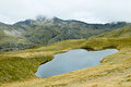 Alpine Tarn on the Lewis Pass Tops Route. Royalty Free Stock Photo