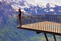 Alpine viewpoint traveler standing on terrace in swiss alps harder kulm Royalty Free Stock Photo