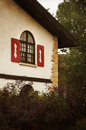 Alpine window cottage in the summer warm inviting building Stock Photos