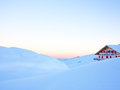 Alpine winter sunrise sublime in the swiss alps with chalet Stock Images
