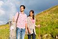 Alps couple hiking in bavarian mountains of men and women on mountain summit or alpine grassland the enjoys the panorama the Stock Photography