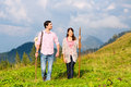 Alps couple hiking in bavarian mountains of men and women on mountain summit or alpine grassland the enjoys the panorama the Royalty Free Stock Images