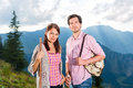 Alps couple hiking in the bavarian mountains young standing on mountain summit enjoying panorama their leisure time or vacation Stock Photo