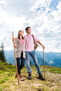 Alps couple hiking in the bavarian mountains young standing on mountain summit enjoying panorama their leisure time or vacation Royalty Free Stock Photography