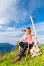 Alps - Hiking Couple takes break in mountains Royalty Free Stock Photo