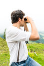 Alps man on mountains with field glasses hiking young in the bavarian looking through a or binocular enjoying the panorama in the Stock Images