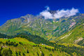 Alps mountains with small clouds landscape Royalty Free Stock Image