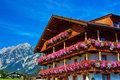 Alps traditional house with flowers Royalty Free Stock Images