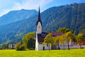 Alps village with cathedral landscape Stock Photography