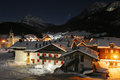 Alps village with u f o in the sky winter night Stock Photos