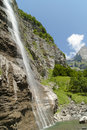The alps waterfall in summer france mountain french montain les alpes haute savoie sixt fer à cheval vertical coulour Royalty Free Stock Photo