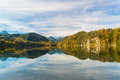 Alpsee in fall sea hohenschwangau near munich bavaria germany Royalty Free Stock Photo
