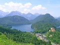 Alpsee with locality of hohenschwangau in front nineteenth century castle on a hill schwansee behind it Royalty Free Stock Photos
