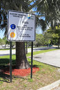 Alsdorf municipal parking lot pompano beach florida february fees sign under a palm tree on a sunny day Stock Photos