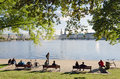 Alster lakeside hamburg germany september a group of young people seated on benches at the edge of lake on september in hamburg Stock Photography