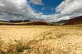 Altai desert mountains the landscape russia with a steppe or semi red at horizon and blue sky with clouds Royalty Free Stock Images